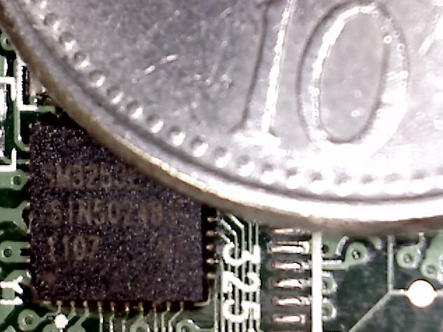 controller chip in focus with 10 pence piece
